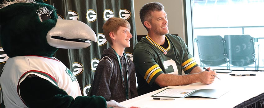 Mason Crosby signing letters of intent with Plash and students