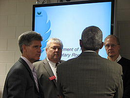 Steve Swan, James Soletski, and Tom Maki chat with Secretary Roger Ervin