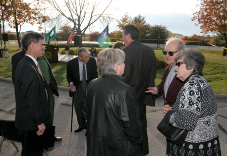 Photo: Sharing a moment are (foreground), founding chancellor Edward Weidner and his wife, Marge, along with Jane Hansen, who attended on behalf of her husband, UW-Green Bay alum and State Sen Dave Hansen, and behind them are Steve Swan and Chancellor Bruce Shepard with members of the Kress family.