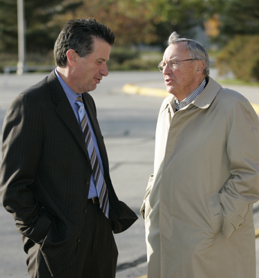 Photo: Chancellor Bruce Shepard and community leader Robert Bush chat prior to the ceremony.