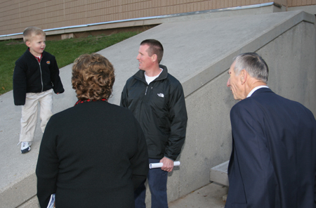 Photo: Three generations of Kresses pause outside the main entrance to the Phoenix Sports Center.