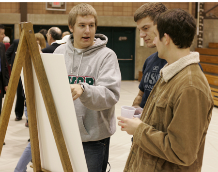 Photo: Students check out sketches of the planned student sports and events center.