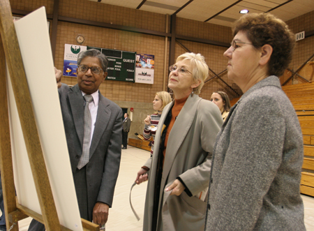 Photo: Prof Kumar Kangayappan, Provost Sue K Hammersmith and library staff member Mary Naumann inspect the sketches.