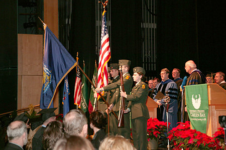 Photo: A color guard from the joint St. Norbert College-UW-Green Bay ROTC program presented the colors.
