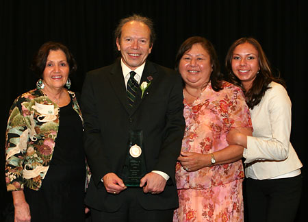 Photo: William Gollnick poses with friend and family at the Distinguished Alumni Award event.