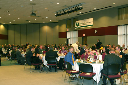 Photo: Guests seated and eating dinner at Distinguished Alumni Awards event.