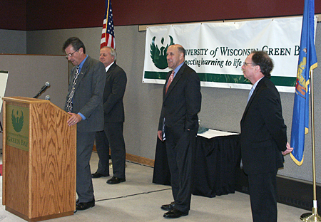 Photo: UW-Green Bay Chancellor Bruce Shepard, state Sen. Dave Hansen, Gov. Doyle and UW System President Kevin Reilly.
