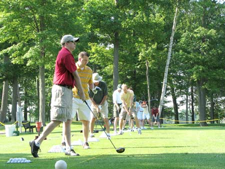 Photo: Golfers at the driving range.