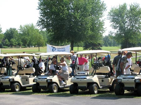 Photo: Golf carts are readied for start of outing.