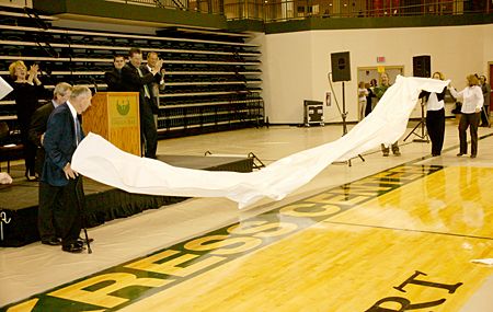 Photo: Ceremonial unveiling of the Kress Center name along the centercourt sidelines.