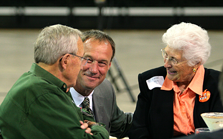 Photo: Green Bay Athletics Director Ken Bothof speaks with Bob and Carol Bush.