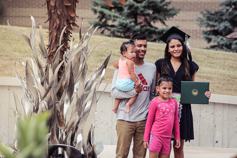 UWGB student with family at graduation