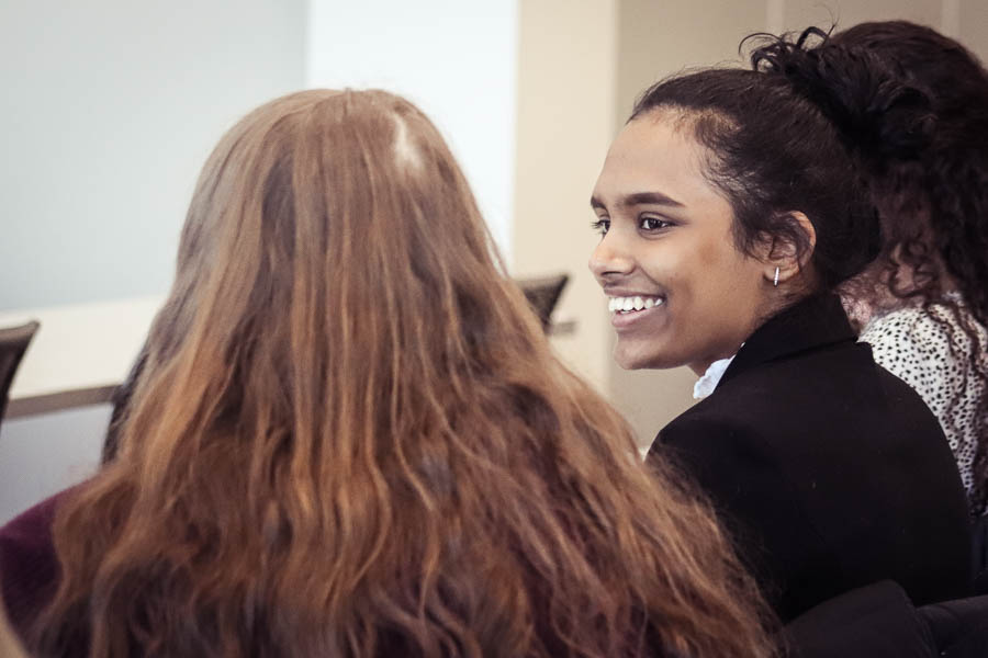 a student smiles at a conference at uwgb