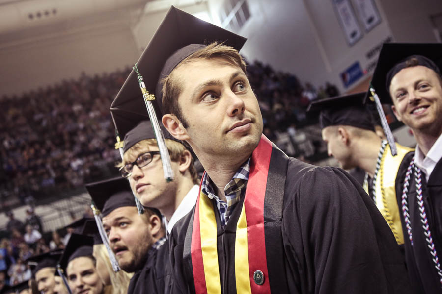A UWGB student taking in their surroundings during graduation.