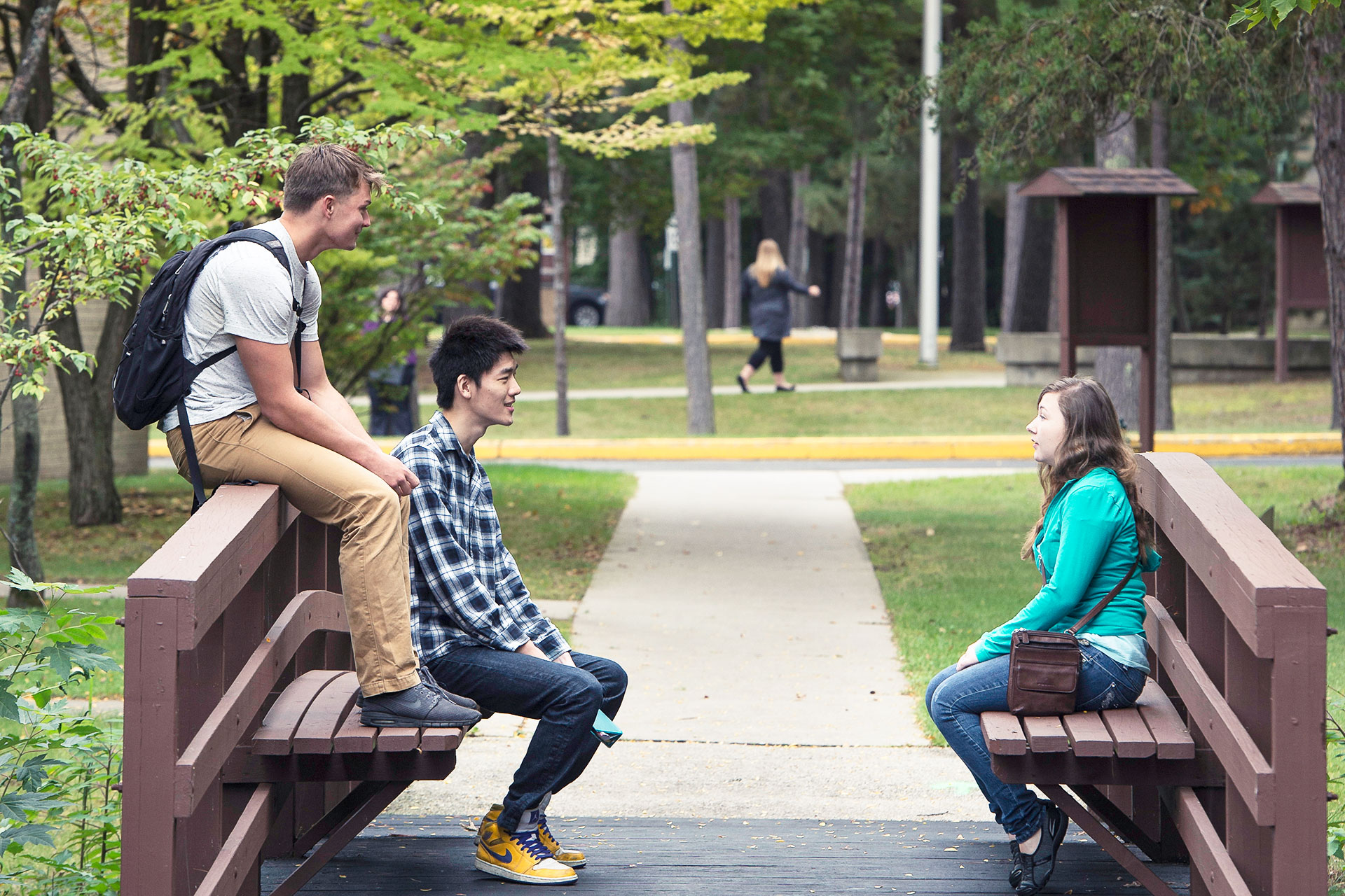 Students sitting on benches in Marinette