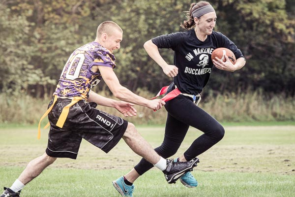 Students play flag football as a part of UW-Green Bay, Marinette Campus intramural sports.