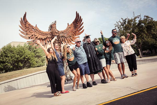 Graduate family in front of Phoenix statue
