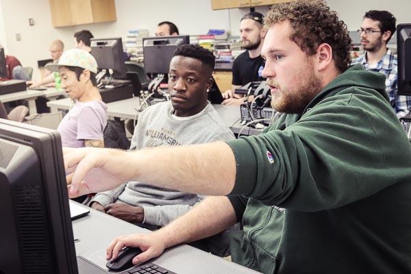 UWGB students working together in a computer lab.
