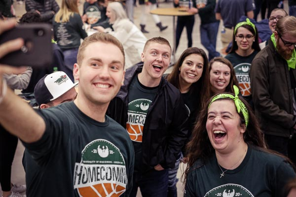 UWGB students take a selfie at the homecoming tailgate.