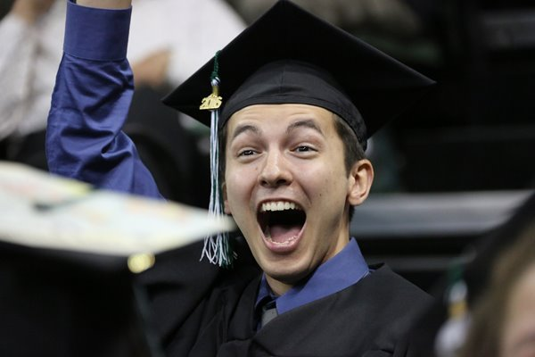 A UW-Green Bay student cheers at graduation.