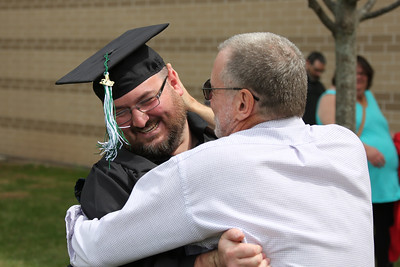 Father and son celebrating graduation