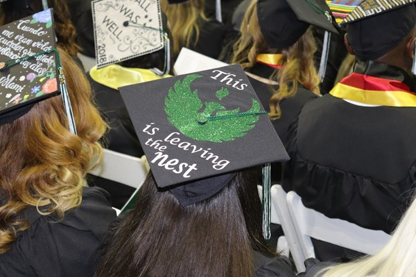 Aerial photo of a student's cap at graduation that reads