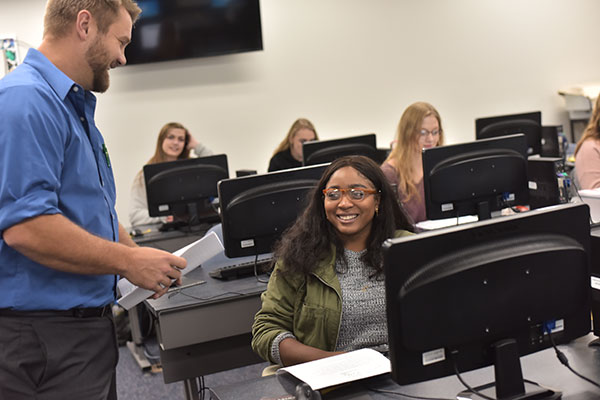 A professor on the UW-Green Bay, Manitowoc Campus helps a student in the computer lab.