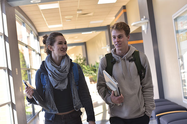 Two students walk down a hallway at the UW-Green Bay, Manitowoc Campus.