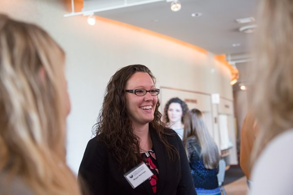 A UW-Green Bay student smiles at an event.