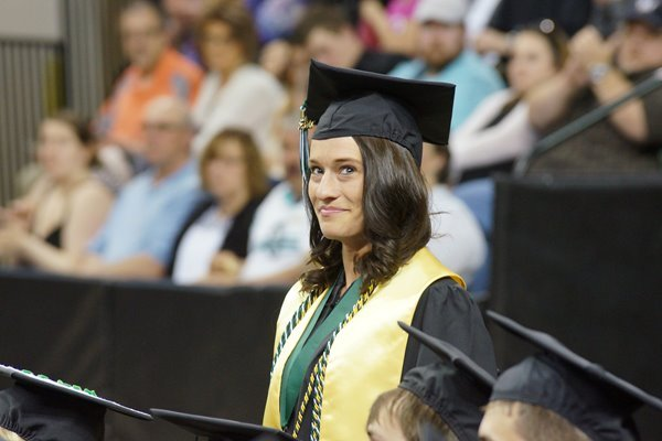 A UWGB student walks down the aisle at commencement.
