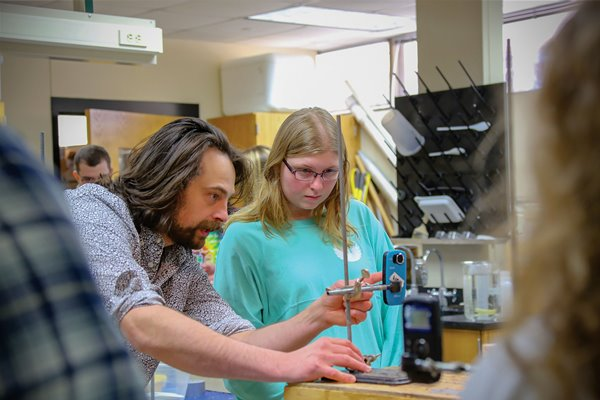 A UW-Green Bay faculty member works with a student in a lab.