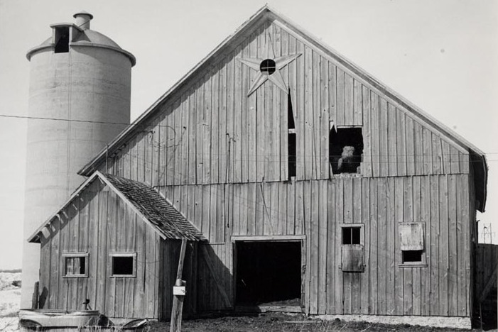 Black and white photograph of a barn
