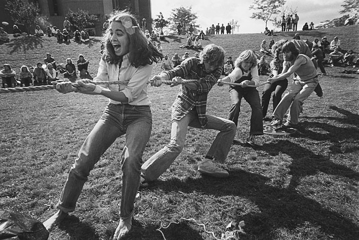 Black and white photograph of people playing tug of war