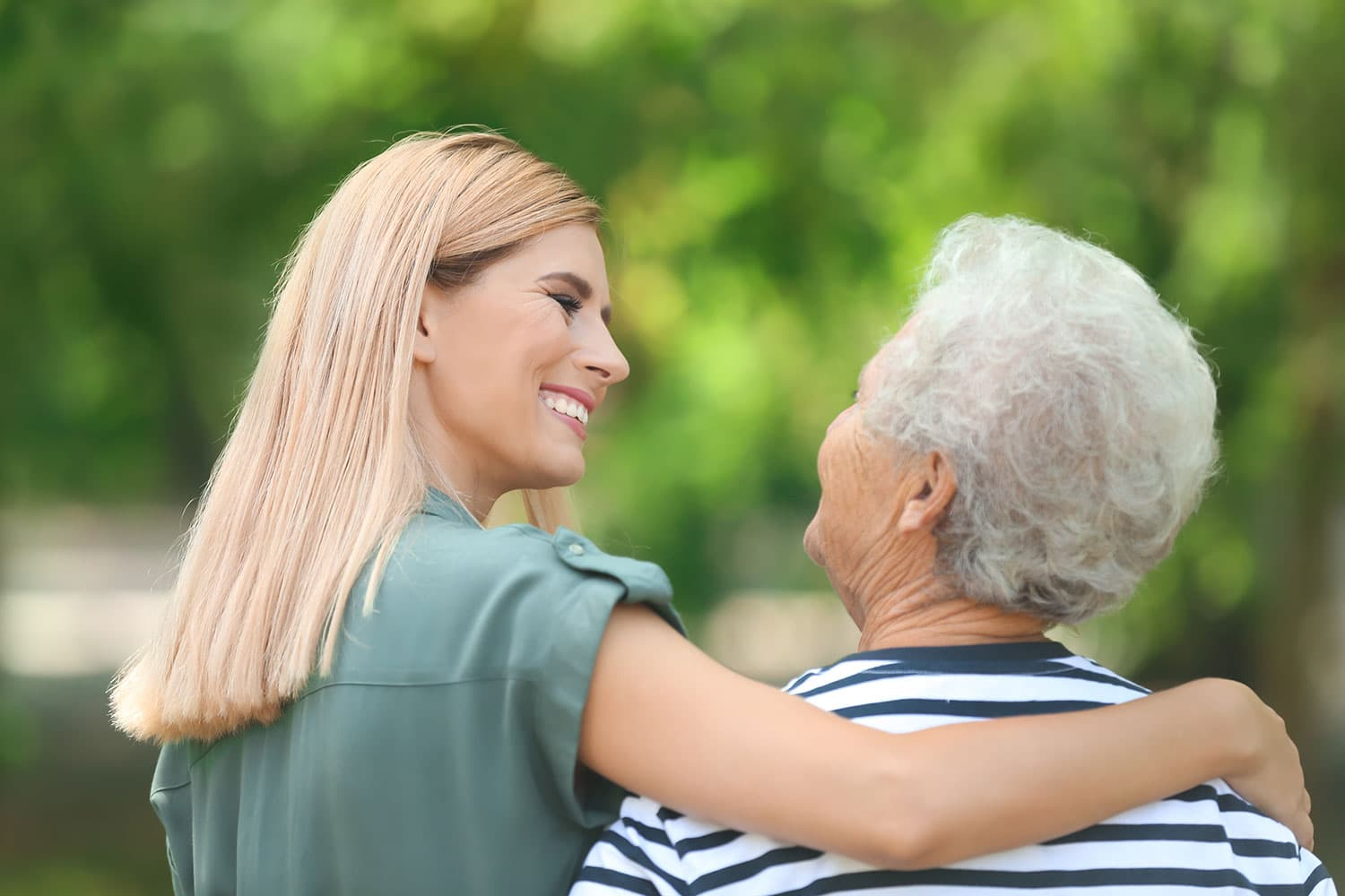 Caregiver helping elderly woman