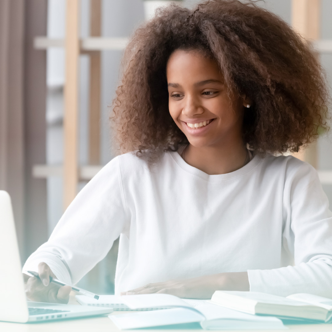 Image of Black female student on a computer studying