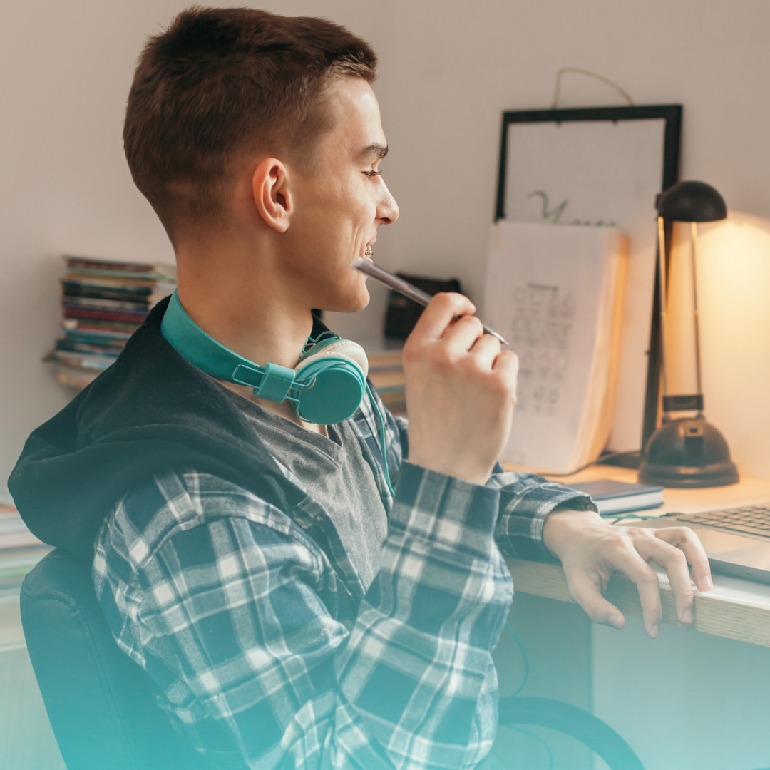 Image of male student studying at the computer