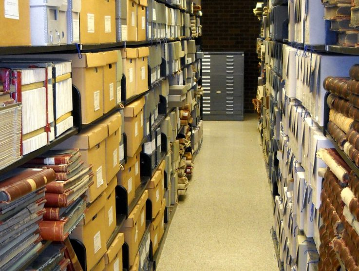 Archival documents stacks on shelves
