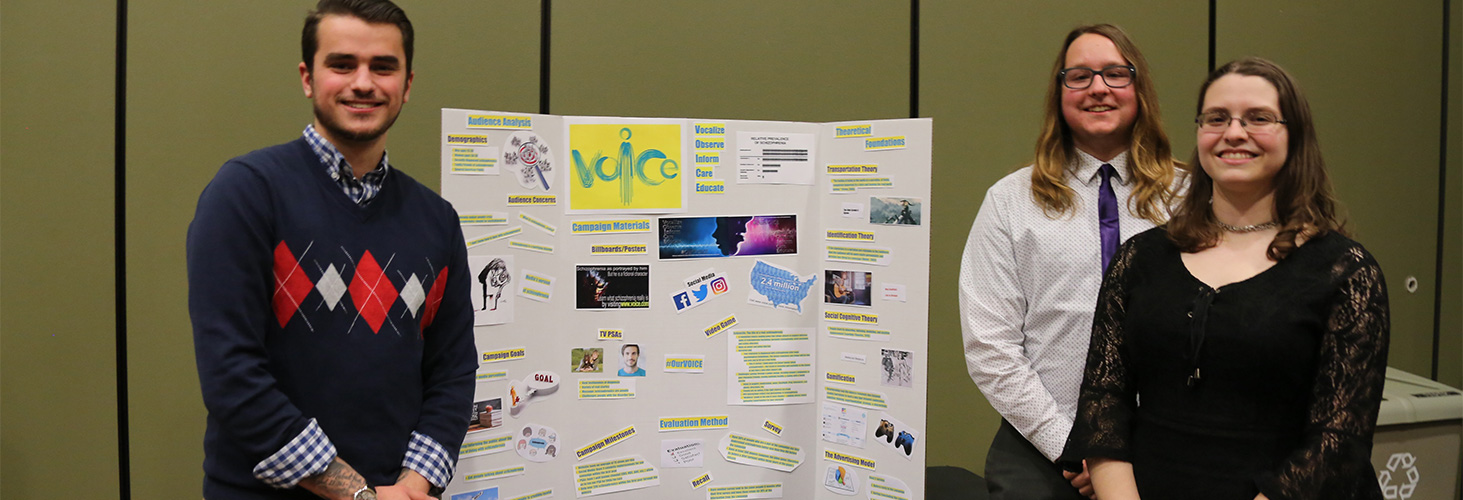 Comm student presenting a poster