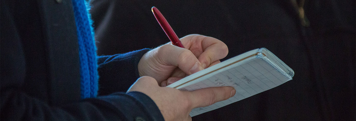 journalist's hands taking notes