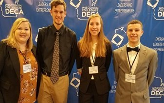 Four people standing together for DECA