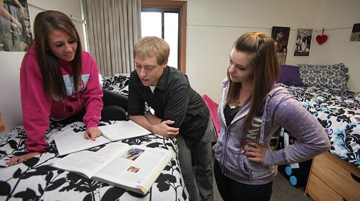 UW-Green Bay students studying in a dorm room